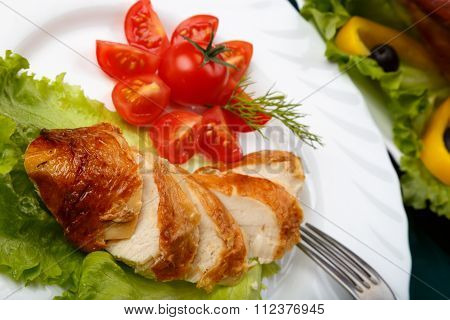 Sliced Roasted Chicken Breast And Served With Fresh Vegetables