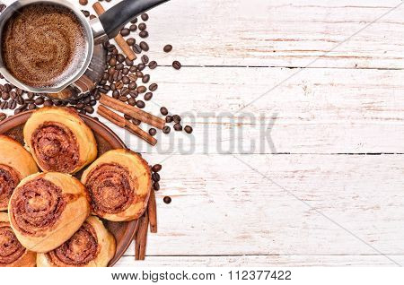 Cinnamon rolls with coffee. Background.