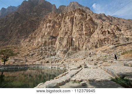 Mountain Landscape With Lake And Trees In Historical Valley With Rocky Reliefs Of Persia.