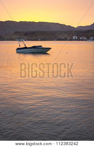 Motor Boat Is Anchored Among The Bay, Evening Sunset On The Beach, Sharm El Sheikh