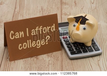 A Golden Piggy Bank With Grad Cap, Card And Calculator On Wood Background