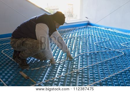 Plumber Working Installed System Radiant Floor