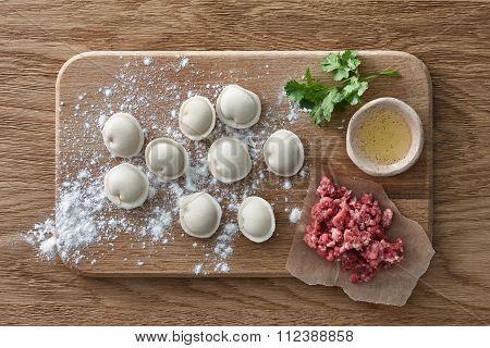 Raw meat dumplings cooking