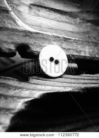 button on wooden background sewing craft
