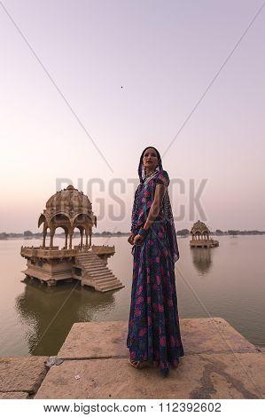 Local Women Standing In The Indian Landmarks The Gadisar Lake.
