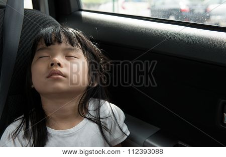 Child Sleeping In The Car
