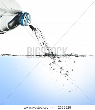 Water pour from water bottle with clipping path