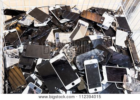 Damaged Smart Phone Body  And Cracked Lcd Screen In Bin
