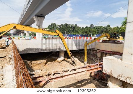 Excavators Digging Ground In Construction Of Tunnel Underpass In City