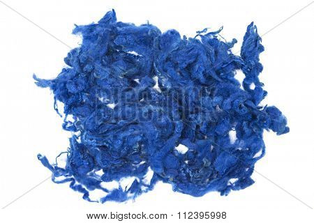 Blue piece of Australian sheep wool Merino breed close-up on a white background.