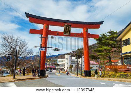 NIKKO JAPAN - NOVEMBER 16 2015: Massive torii gate of Futarasan Shrine at the front of lake Chuzenji in NIkko