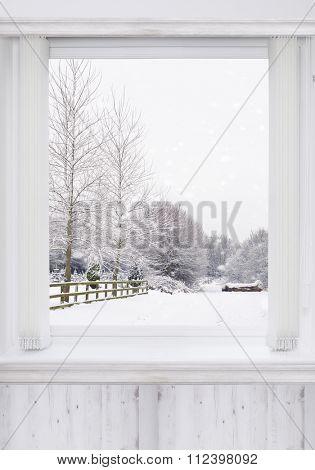 Window overlooking snowy country lane