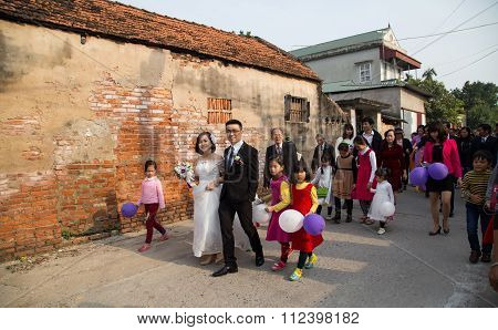 A wedding with bridal and groom of a just married couple on a country road