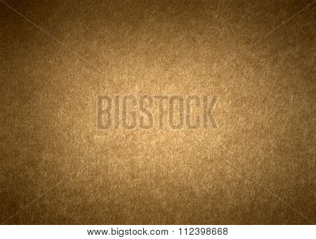 Section of brown textured wrapping paper with dark vignetted edges