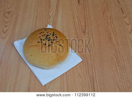 red bean filling bun on tissue paper