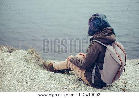 Traveler Resting On Steep Coast