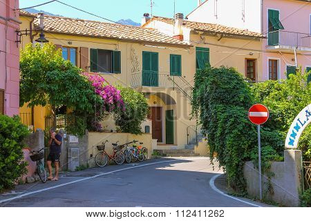 Talking On The Phone Man On Narrow Street Of Small Picturesque Town Marciana Marina On Elba Island,