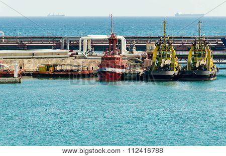 Small tug boat in cargo port