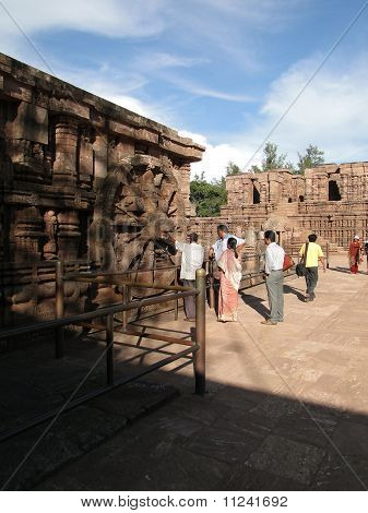 Indian Tourists Examine The Huge Chariot Wheel