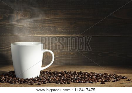 Coffee Cup And Coffee Beans.
