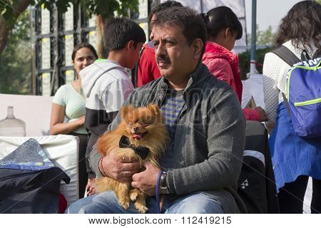 A Man With His Pomeranian Dog