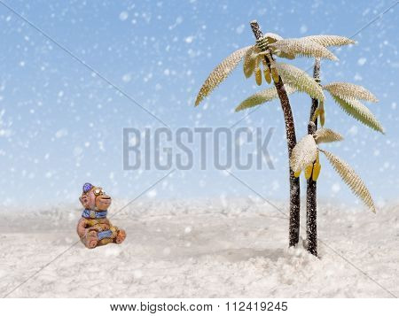 Clay Monkey Looks At The Snow Falling From The Sky Near The Snow-covered Palm Trees