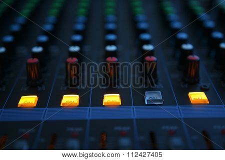 Close Up Of The Rows Of Knobs And Sliders On An Analogue Mixing Console