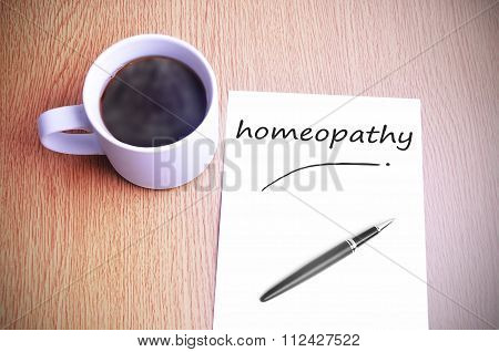 Coffee On The Table With Note Writing Homeopathy
