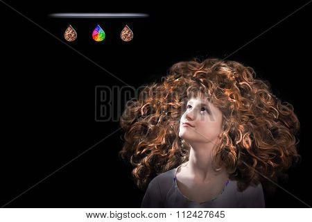 The girl's face and a lot of curly red hair