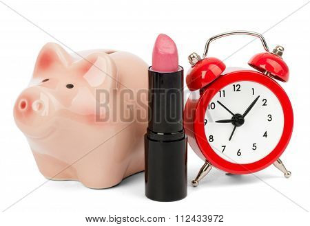 Lipstick with piggy bank and alarm clock