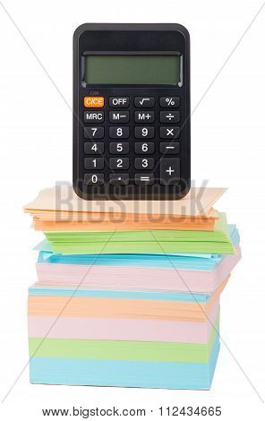 Calculator on stack of stickers