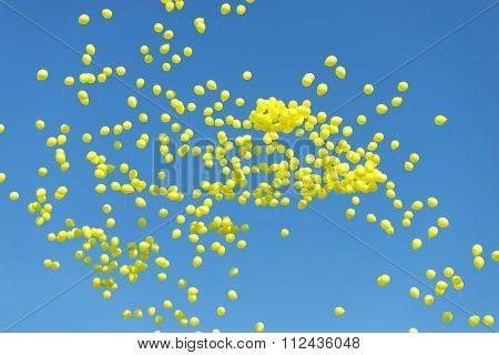 Thousands Of Yellow Balloons Floating In The Sky
