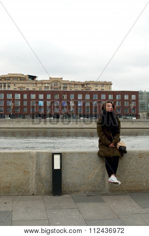 Girl Sitting On The Bank Of Moscow-river