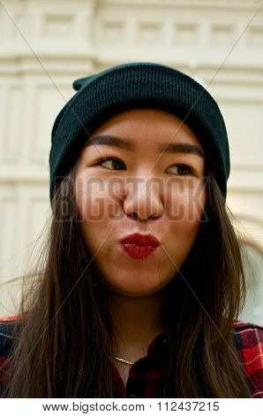 Portrait Of A Girl Making Kiss