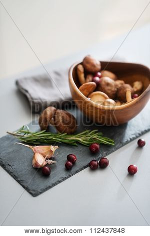 Closeup Of Autumn Fruits And Mushrooms In A Wooden Bowl