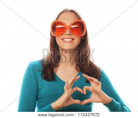 Party image. Playful young woman with big party glasses. Ready for good time