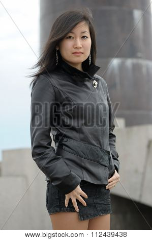 Asian woman in black jacket at park