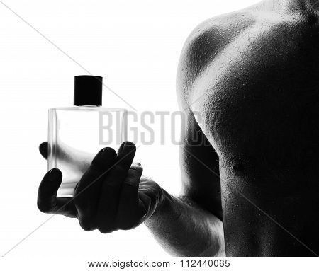 Muscular Handsome Man With Perfume Bottle