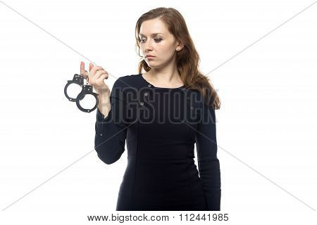 Thinking woman with handcuffs
