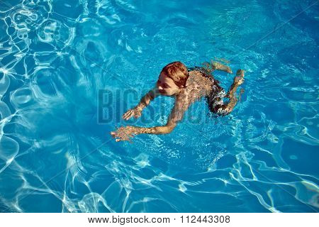 Child Swims In The Pool
