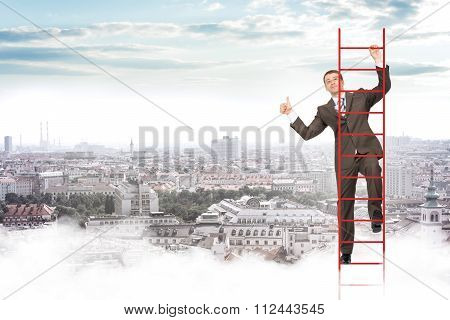 Smiling businessman climbing ladder in sky