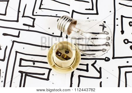 Incandescent Lamp With A Chuck On The Background