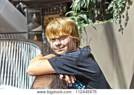 Smiling Boy Inside A Center