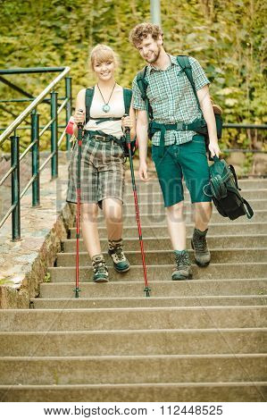 Two People Tourists Hiking Walking On Stairs.
