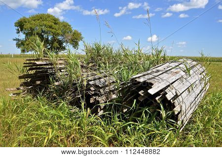 Old rolled up wood snow fence