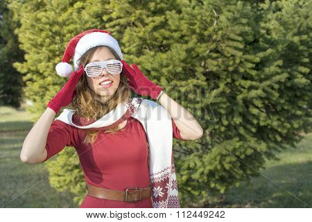 Portrait Of A Beautiful Santa Claus Girl With Party Glasses