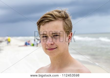 Young Happy Boy Looking Handsome At The Beach