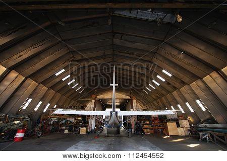 Hangar with modern airplane inside.