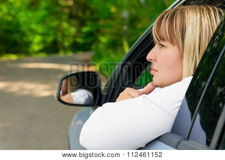 Pensive Female Driver 50 Years Looking Out The Window