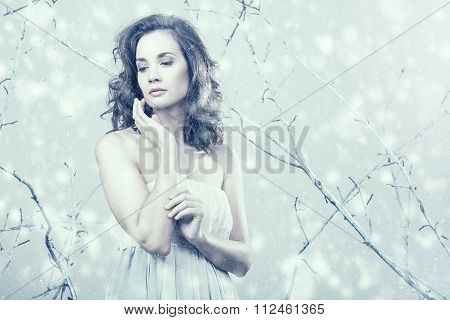 Romantic Girl Looking Away In Dress On Winter Fantasy Set Up